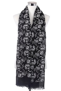 Wisteria London black embossed carnation print frayed hem scarf. Also available in Grey and Mustard