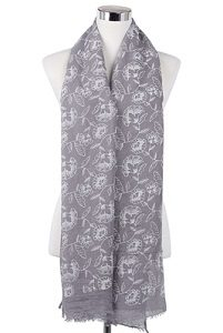 Wisteria London Alice Floral Print Scarf. Grey embossed carnation print frayed hem scarf. Als available in Black and Mustard