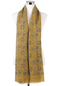 Wisteria London Mustard embossed carnation print frayed hem scarf. Also available in Black and Grey