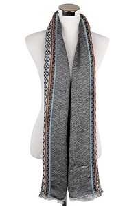 Wisteria London black scarf accented with a tribal diamond print pattern and finished with frayed edges. Also available in Grey and Brown