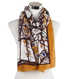 Wisteria London mustard bold abstract branches and floral print frayed scarf. Also available in Grey