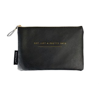 Alice Scott Black Makeup Bag featuring gold lettering detail with the quote 'Not Just a Pretty Face.' It has a stylish humbug stripe lining, is made from PU and has a zip fastening.