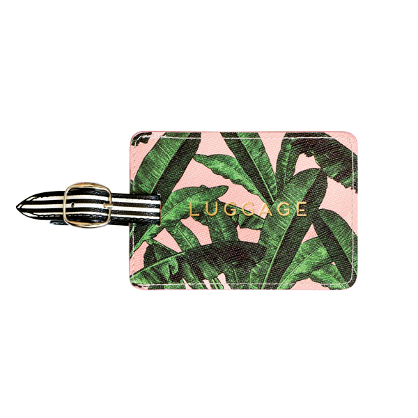 Alice Scott Travel Accessories - Luggage Tag. Adorned with a pink and banana leaf design it features the word 'Luggage' in gld foil detailing. The luggage tag also has a buckle detail used to attach to your suitcase