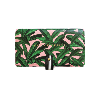 Alice Scott Travel Document Wallet, Travel Document Holder and Passport Holder. The must have travel accessory. This handy travel wallet will store your passport, boarding card, currency, tickets and any spare change you may have. Adrned in a beautiful pink and banana leaf print the front of the travel wallet feautures the words 'Out of Office' in gold foil detailing