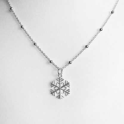 "Sterling Silver Snowflake Necklace on Bobble Chain. Chain is 18"". Also available on an 18"" sterling silver diamond cut cable chain"
