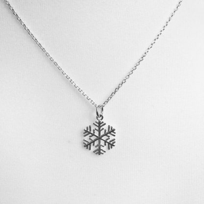 "Sterling Silver Snowflake Necklace on a 18"" diamond cut cable chain. Also available on an 18"" sterling silver bobble chain"