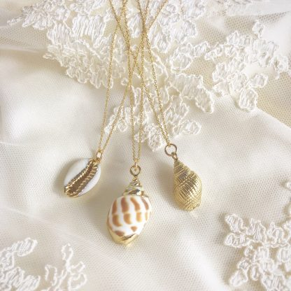 Shelly Gold Conch Shell Necklace, Mira Natural Conch Shell Necklace and Helen Gold Cowrie Shell Necklace